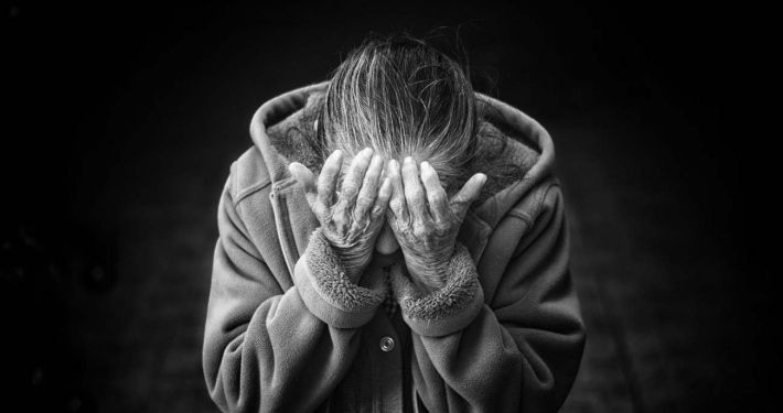 Grief and Anger, Alzhiemers Disease woman with face in hands